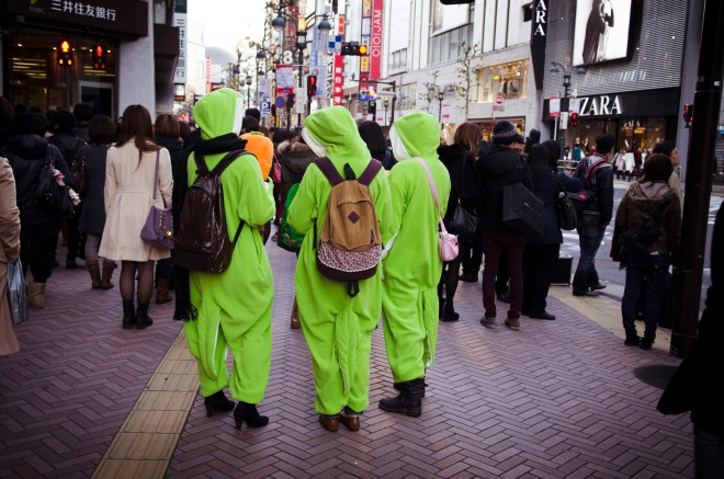 Shibuya girls. In some dino costume?