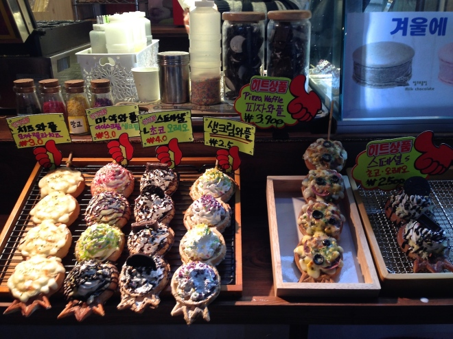 Hongdae street snacks! Mini waffles on a stick - crispy and fluffy with cream and various toppings. Yum.