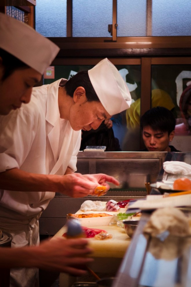The chef in Sushi Dai fully focused while creating his masterpiece.
