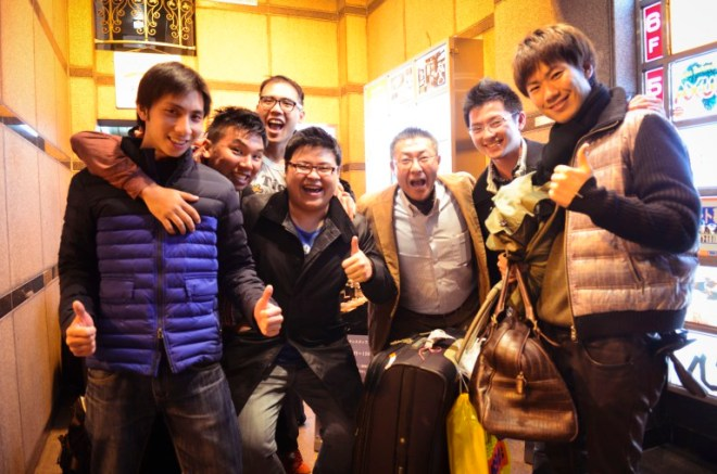 Us in front of the African pub with Mr Toshi Kanda and his son, Eiji on the right.