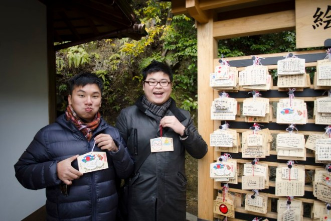 Timothy and me with our Ema (絵馬) – wooden wishing plaques of Japanese shrines