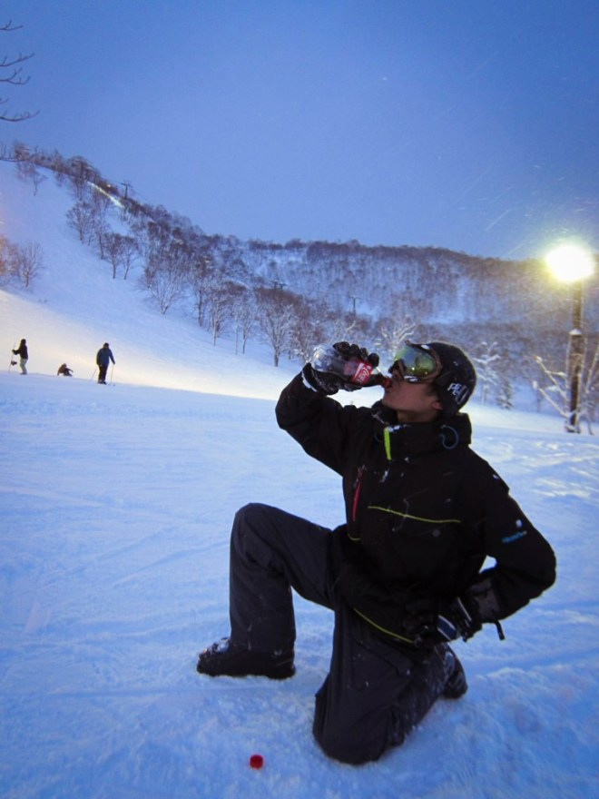 Rizky chugging his Coke after skiing. It's apparently some sort of statement.